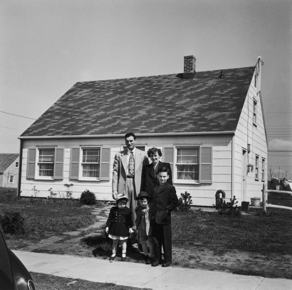 Bernard-Levey-family-in-front-of-original-Cape-Cod.jpg