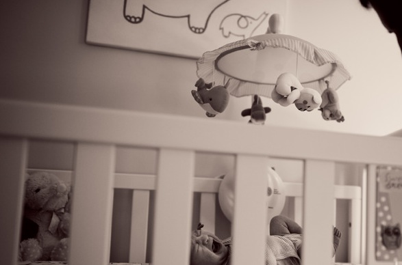 San-Francisco-Bay-Area-newborn-lifestyle-photography-baby-girl-crying-in-her-crib-while-dad-tries-to-soothe-BxW.jpg