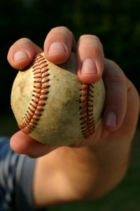 close-up-of-hand-and-fingers-gripping-baseball-200x300.jpg
