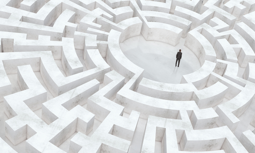 person-stuck-in-middle-of-maze.jpg