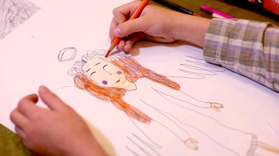 stock-footage-close-up-of-a-young-childs-hand-coloring-christmas-angel.jpg