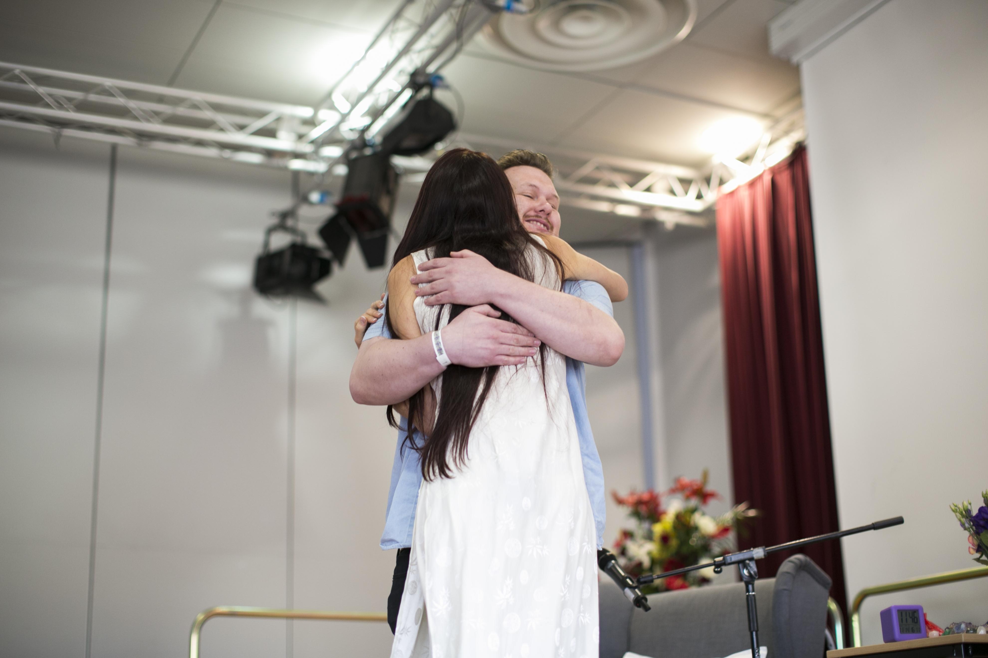 Dublin Teal on stage hug
